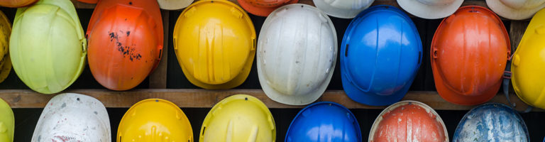 Success Story - multicolored hard hats